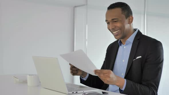 Cover Image for Casual Afro-American Businessman Reacting To Successful Contract