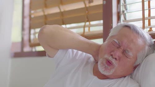 Asian Elderly senior man neck and shoulder pain and injury muscle upper back problem