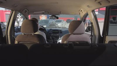 Woman in Face Mask Entering Taxi