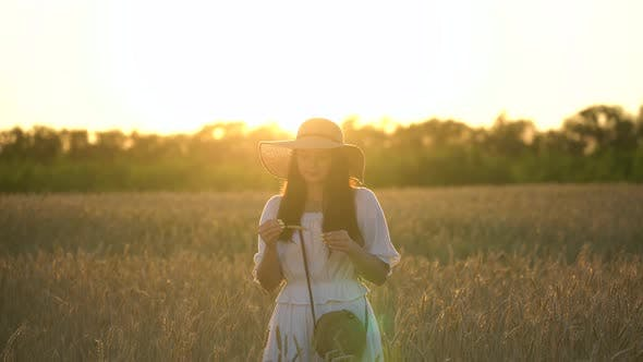 Thumbnail for Young Girl With Straw Hat in Wheat Field