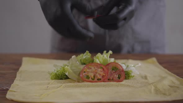 Thumbnail for Hands of the Chef in Black Kitchen Gloves Making Shawarma