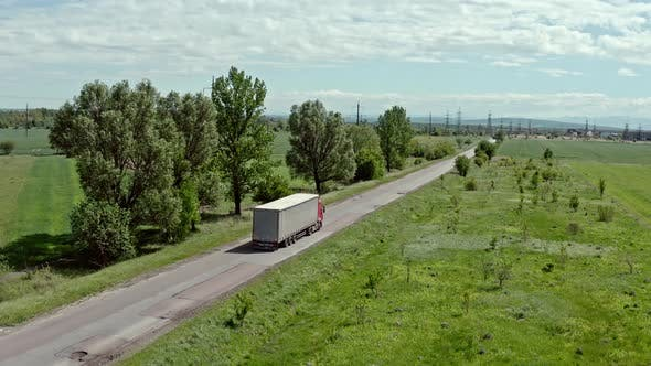 Thumbnail for Aerial Top View of Truck with White Cargo Semi Trailer Moving on Road