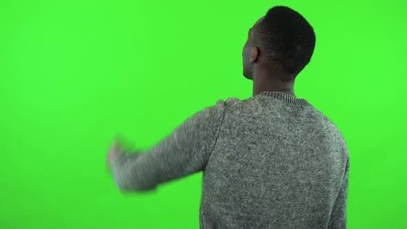Thumbnail for A Black Man Cheers with His Back To the Camera - Green Screen Studio