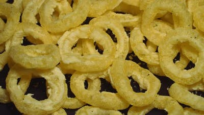 Rotating Corn Rings on a Black Background
