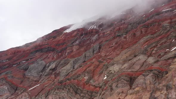 Thumbnail for Video showing the grey brown and red colored stony layers and a gletser