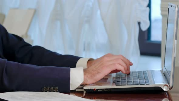 Thumbnail for Businessman Is Typing on Laptop Computer