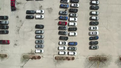 Aerial Drone Shot of the Car on Parking of the Dealer Lot and Car Carrier Trailer Car Hauler Loads