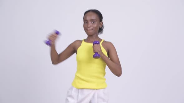 Cover Image for Happy Young Beautiful African Woman Exercising with Dumbbells