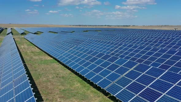Thumbnail for Fly Over Many Panels of Solar Cells