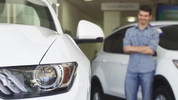 Thumbnail for Male Customer Smiling Looking at the New Auto at the Dealership