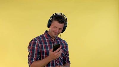 Handsome Man in Headphones Enjoying Listening to the Music