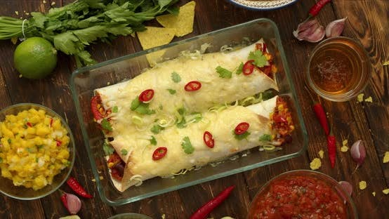 Homemade Vegetable Burritos Served in Heatproof Dish. With Salsa, Guacamole, Nachos and Ingredients
