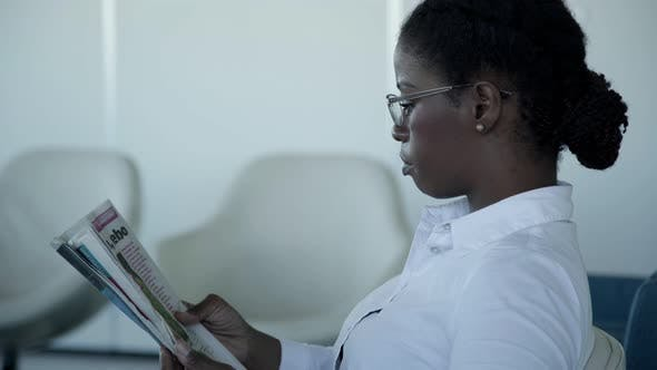 Thumbnail for Serious Businesswoman Reading Newspaper
