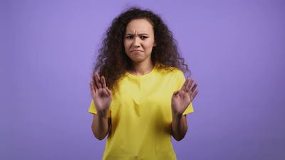 Portrait of Woman Showing Rejecting Gesture By Stop Finger Sign
