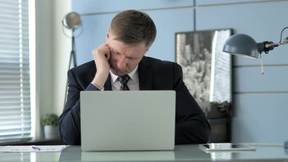 Cover Image for Businessman Sleeping at Work