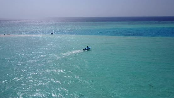 Thumbnail for Daytime fly over abstract shot of a paradise sunny white sand beach and blue ocean background in vib