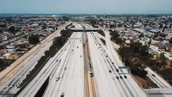 Cover Image for Amazing Cinematic Aerial Shot of Busy American Interstate Highway with Heavy Car Traffic Moving on