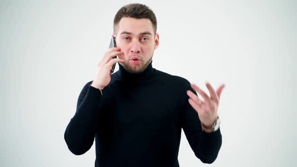 Thumbnail for Portrait of a handsome man talking the phone