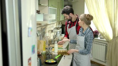 Couple Cooking and Laughing.