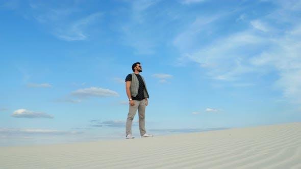 Thumbnail for Man Traveling in Desert