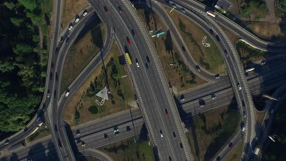 Thumbnail for Car Driving on Freeway Overpass, Aerial View Car Traffic on Roundabout Highway