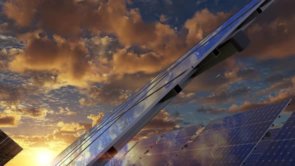 Solar Energy Panels Against Red Sunset Sky Producing Electricity From Sunlight