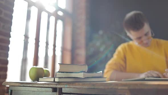 Thumbnail for Young Student Writing the Notes