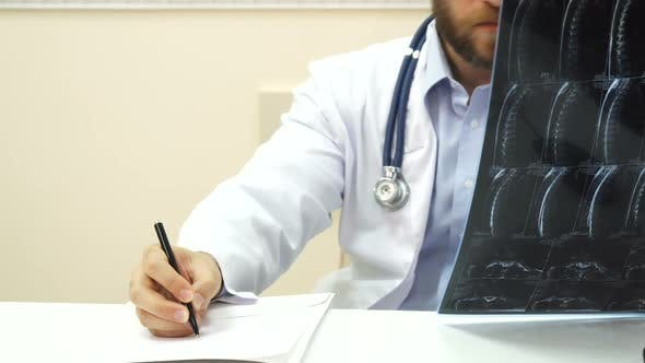 Thumbnail for The Doctor Is Analyzing the Patients X-Ray