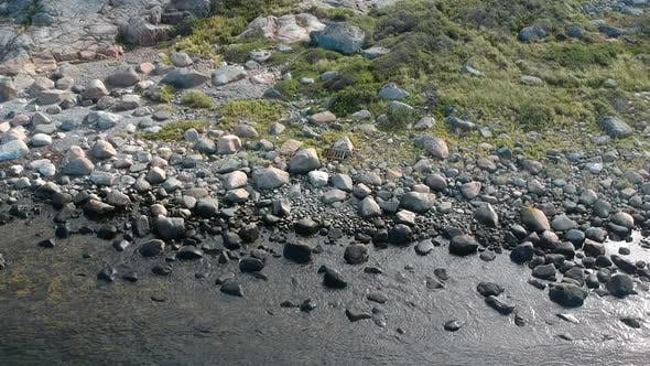 Thumbnail for Aerial Drone Shot of A Rocky Beach Ocean Coastline