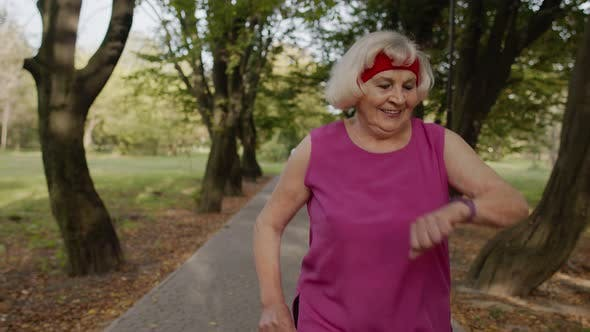 Thumbnail for Senior Runner Woman Training Outside, Enjoying Nature. Workout Cardio at Morning. Healthy Lifestyle