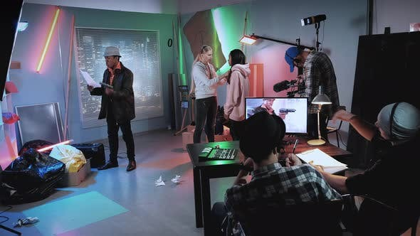 Thumbnail for Mixed Race Stars and Crew Preparing for the Scene in Modern Film Studio