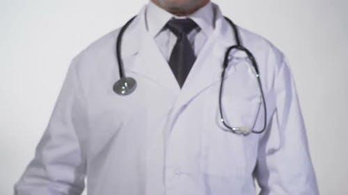 Dieting Written on Blackboard in Doctor Hands Nutritionist Recommendations