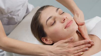 Young Woman on Procedure for Face in Beautician