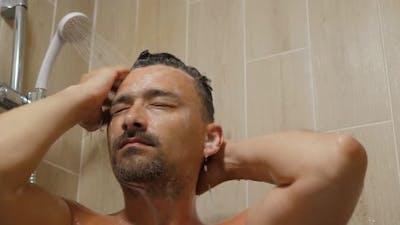 Man Cleans His Head