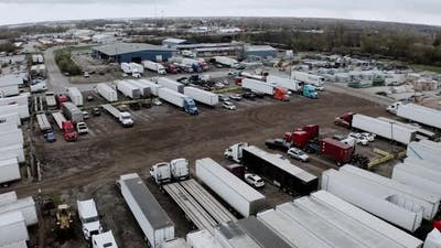 Aerial Drone View of Truck Repair Shop Service Building and Many Trucks Near It USA