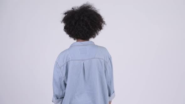 Thumbnail for Rear View of Young African Woman Waiting and Thinking