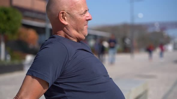 Cover Image for Profile of Concentrated Bald Man Exercising on Street