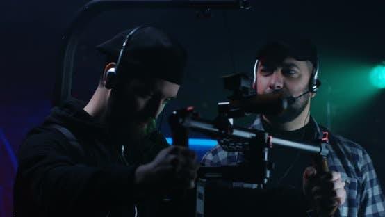Director Instructing Young Cameraman