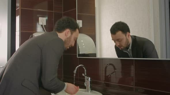 Thumbnail for Businessman Washing Face in Bathroom
