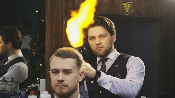 Cover Image for Professional Barber Working Burning Fire Hair Treatment on His Client