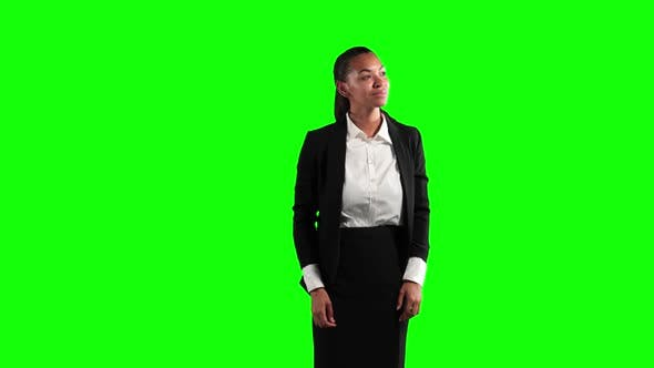 Thumbnail for a mixed race woman in suit in a green background