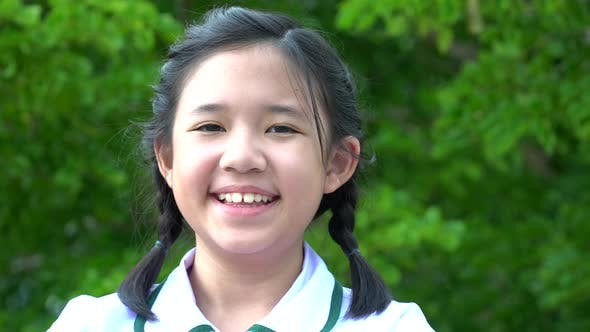 Close Up Of Asian Girl Smiling Outdoor