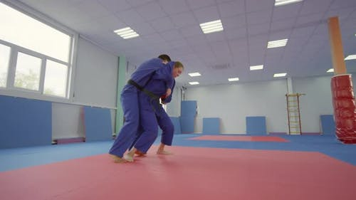 Female Martial Arts Fighter Training with Male Partner