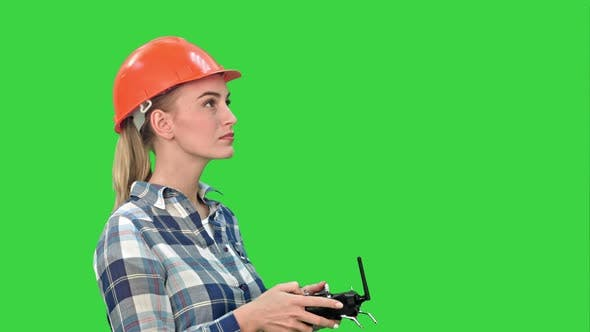 Thumbnail for Female Engineer Operating a Drone Analyzing Object on a Green Screen, Chroma Key