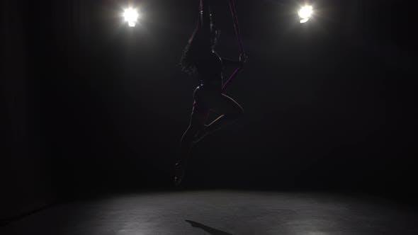 Girl Dancing with Aerial Silk Flying Wings in Black Background 068