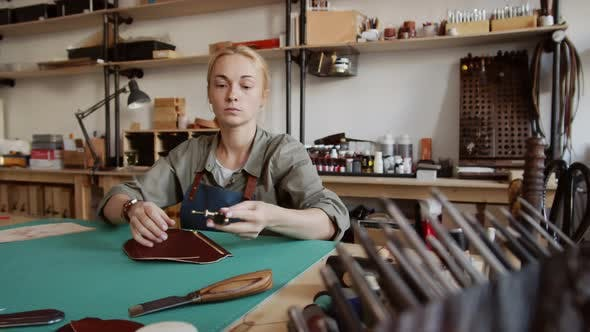 Thumbnail for Caucasian Craftswoman Making Purse in Tannery