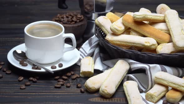 Cover Image for Italian Savoiardi Ladyfingers Biscuits in Basket and Coffee on Wooden Background
