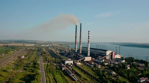 Thumbnail for Aerial Drone View of High Chimney Pipes with Grey Smoke From Coal Power Plant. Wide View