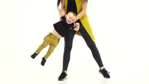 Thumbnail for Kid Laughs and His Mother Turns, White Background, Slow Motion