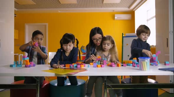 Cover Image for Kids Playing with Construction Blocks in Classroom
